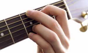 Strum and Sip: Four or Eight Weekly Group Guitar Lessons at Strum and Sip (Up to 71% Off)