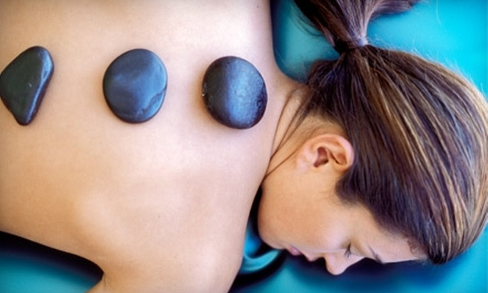 Orchid Body and Skin Therapy - Durham: Hot-Stone Massage or Waxing Services at Orchid Body and Skin Therapy in Durham. Three Options Available.