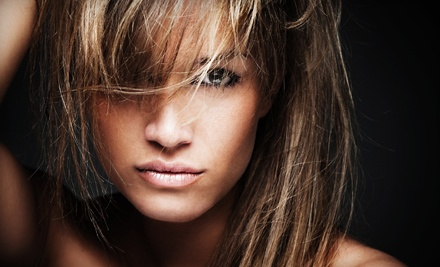 Haircut with Massaging Shampoo, Deep Conditioner, and Flat-Iron Styling (a $79.95 value) - Above and Beyond Hair and Nail Salon in Leominster