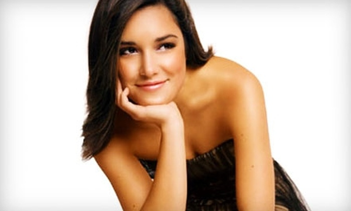 Palm Beach Tan - Prairieville: $30 for Four Mystic HD Spray Tans ($120 Value) or $49 for 12  Red-Light Therapy Sessions ($149 Value) at Palm Beach Tan