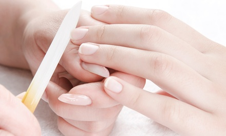One or Two Basic Mani-Pedis at Queen Nails Beauty Salon (Up to 31% Off)