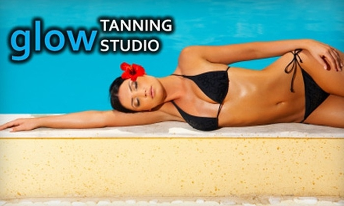 Glow Tanning Studio - Cold Spring: $29 for Three Spray-Tanning Sessions or Four High-Pressure UV Tanning Sessions at Glow Tanning Studio ($59 Value)