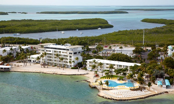 null - Orlando: Stay at Postcard Inn Beach Resort & Marina at Holiday Isle in the Florida Keys. Dates Available into February.