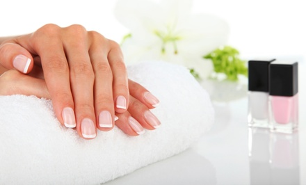 Regular Manicure or Acrylic Full Set with Standard Pedicure at The Nail Club (Up to 44% Off)
