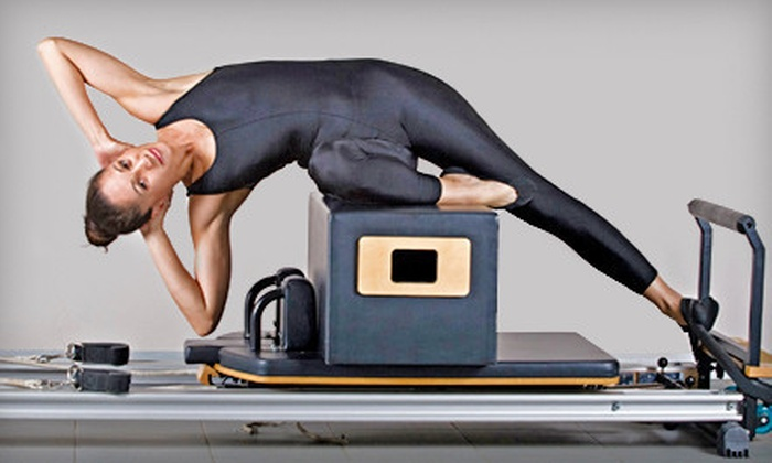 Total Body Pilates - Total Body Pilates: $45 for Four Reformer Classes and Four Mat Classes at Total Body Pilates ($160 Value)