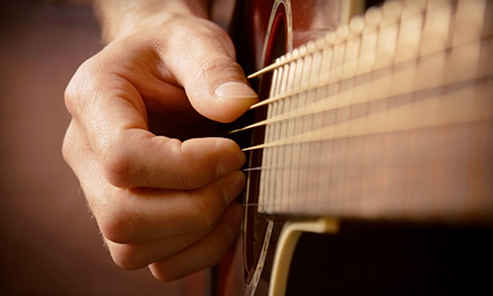 String Theory Music Lessons - Deyerle: $40 for Four Half-Hour Group Music Lessons in Bass or Guitar at String Theory Music Lessons ($80 Value)