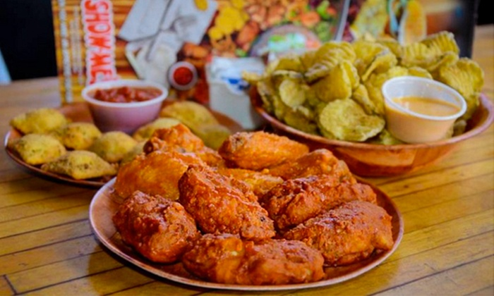 Show-Me's - Citrus Park Community: Wings, Burgers, and Seafood at Show-Me's (Up to 40%Off). Three Options Available.