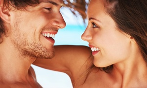 Sun City Tanning: Month of Unlimited Level 2 Tanning or One or Three Spray Tans at Sun City Tanning (Up to 72% Off)