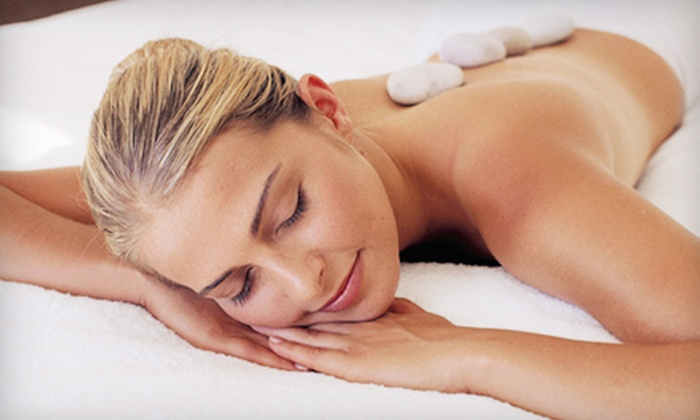 Jung Ja International Salon and Spa - Coon Rapids: Hot-Stone Massage Package or Elemental Nature Facial Package at Jung Ja International Salon and Spa (Up to 65% Off)