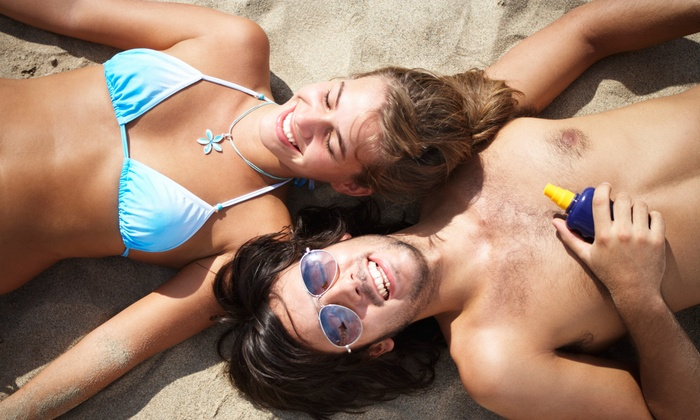 Oceanside Tanning - Cambridge- Hespeler: Two Spray Tans or One Month of Unlimited Regular UV Tanning at Oceanside Tanning (Up to 52% Off)