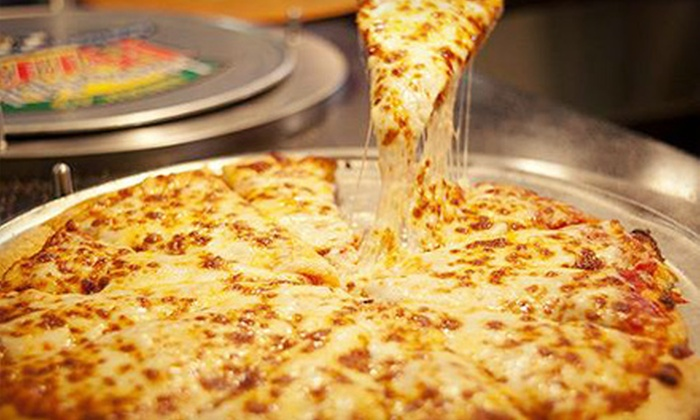 Tulsa's Incredible Pizza Company - Tulsa's Incredible Pizza Company: Buffet, Drinks, and Games for Two or Four at Tulsa's Incredible Pizza Company (Half Off)