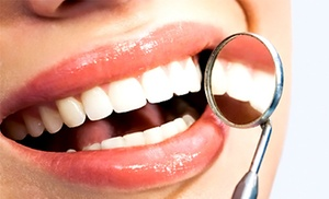 Dennis Sigman, D.D.S.: Dental Exam and X-rays with Optional Take-Home Teeth-Whitening Kit from Dennis Sigman, D.D.S. (Up to 67% Off)
