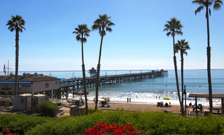 groupon daily deal - 1- or 2-Night Stay for Two in a King or Double-Queen Room at Patriots Boutique Motel in San Clemente, CA