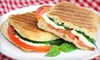 Dalton Distillery - Downtown Asheville: $16 for Two Paninis or Stromboli and a Take-Home Six Pack of Beer at Adam Dalton Distillery (Up to $40 Value)