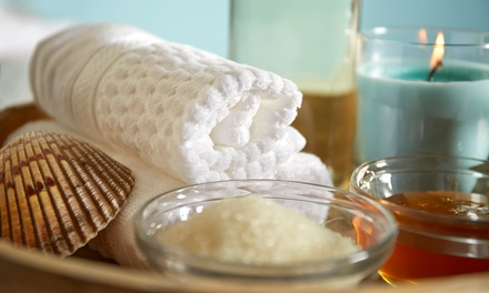 One or Three Groupons, Each Good for One 60-Minute Sea-Salt Foot Scrub at New Happy Day Spa (Up to 42% Off)