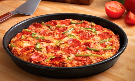 Pan Pizza, Parmesan Bread Bites, and Coca-Cola Soda at Domino's Pizza (Up to 47% Off)