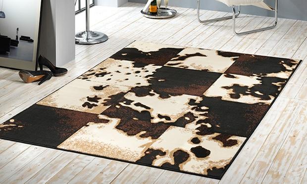 teppich kuh oder zebrafell look welt der rabatte. Black Bedroom Furniture Sets. Home Design Ideas