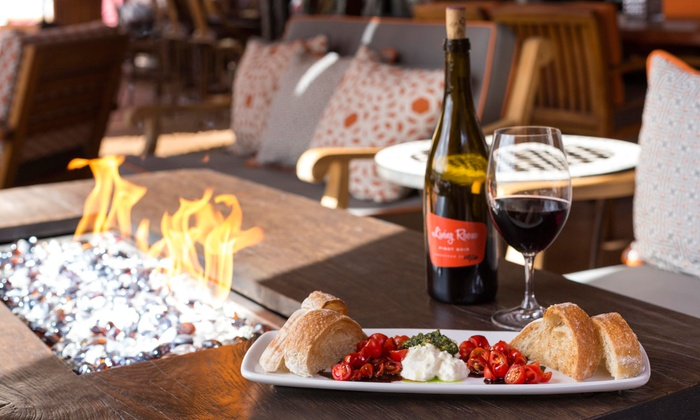 The Living Room Wine Cafe & Lounge - La Encantada: $17 for $30 worth of Wine, Tapas, and Burgers at The Living Room Wine Café & Lounge