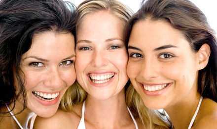 $3,100 for a Complete Invisalign Treatment with Teeth Whitening at Smashing Smiles Orthodontics ($7,875 Value)