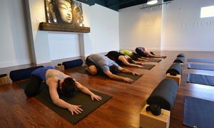 Om Yoga: 10 or 20 Heated and Non-heated Classes at Om Yoga (73% Off)