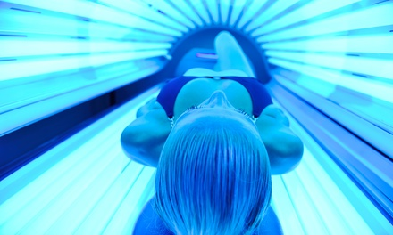 One or Two Months of Tanning, or One Year of Tanning with Bottle of Lotion at 4 Ever Tan (Up to 66% Off)