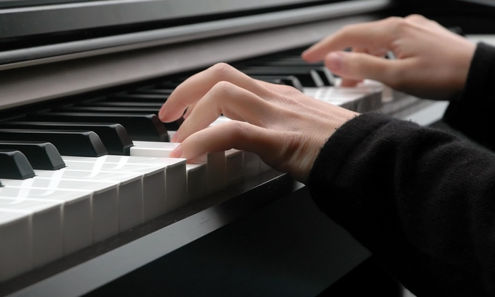 Music Lessons with Amy - Wall: Four-Day Musical Instrument Course at Music Lessons with Amy (50% Off)