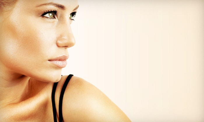 Glowing Gold Tanning Spa - Hialeah: Two or Four VersaSpa Spray Tans or One or Two Weeks of Unlimited UV Tanning at Glowing Gold Tanning Spa (Up to 88% Off)