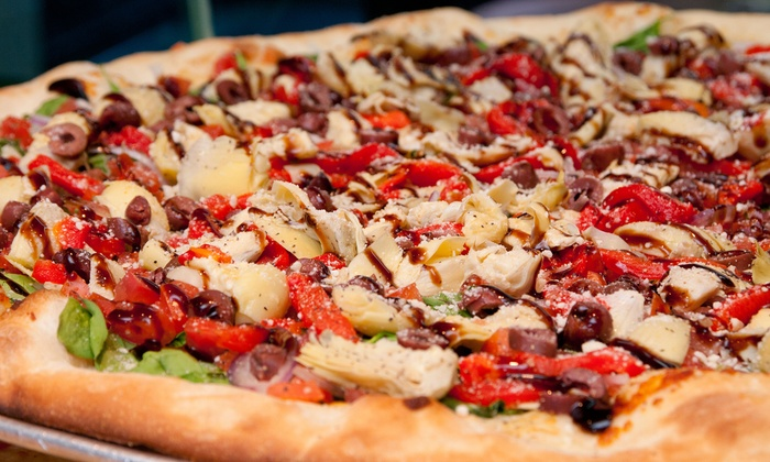 Slices Pizza Joint - Holladay: $12 for Two Groupons, Each Good for $10 Worth of Pizza at Slices Pizza Joint ($20 Total Value)