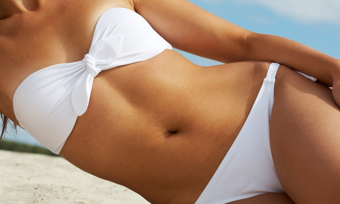 Electric Beach Tanning & Spa - Downtown: Two Spray Tans or 10 UV Tanning Sessions in Low- or High-Level Beds at Electric Beach Tanning & Spa (Up to 62% Off)