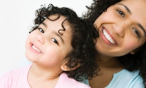 KidzTown Dental: Exam, X-ray, Cleaning, and Fluoride for One Kid or Adult at KidzTown Dental (Up to 75% Off)