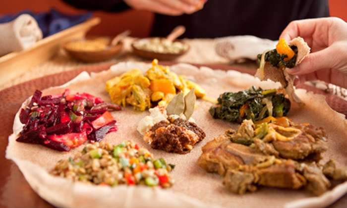 Axum Restaurant - Park Hill: Ethiopian Meal for Two or Four with Appetizers, Entrees, and Dessert at Axum Restaurant (Up to 51% Off)