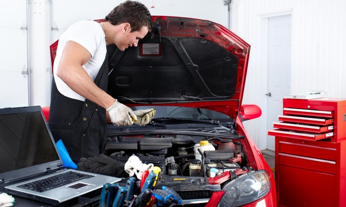 Furtraders Auto Repair - Tacoma: One or Three Oil and Filter Changes with Full-Point Inspections at Furtraders Auto Repair (Up to 64% Off)