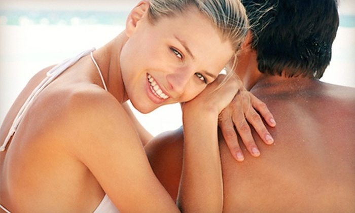 Xtreme Tan - Multiple Locations: One Month of Unlimited UV Tanning in Level 1-3 Beds or Two Airbrush or Spray Tans at Xtreme Tan (Up to 68% Off)