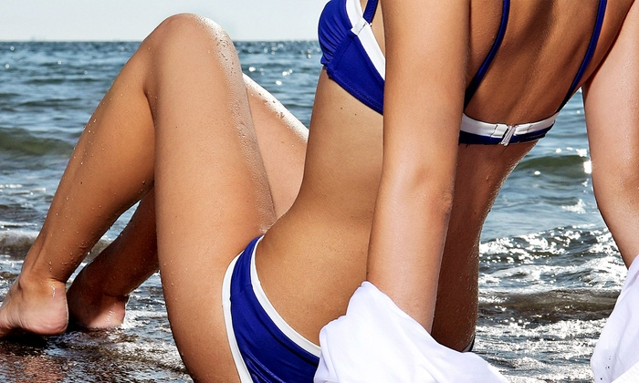 Summer Haze - Summer Haze: One Spray Tan, or One Month or One Year of UV Tanning at Summer Haze (Up to 60% Off)