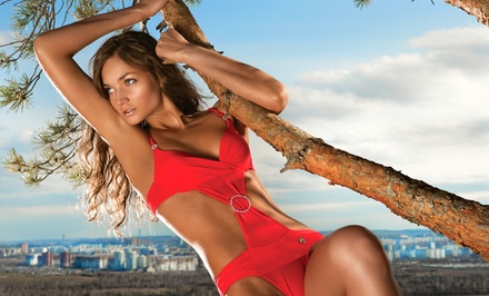 One Month of Unlimited UV Tanning, or Three Custom Spray Tans at South Beach Tanning Salon (Up to 62% Off)