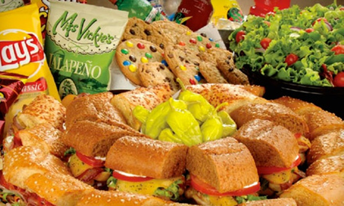 Quiznos - North Hollywood: $8 for $16 Worth of Sandwiches, or a Large Classic Sub Tray and Fresh Garden Salad Bowl for 10 People at Quiznos