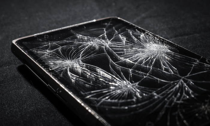 Ist Comm - Lincoln Square: iPhone or iPad Screen Repair at Ist Comm (Up to 55% Off). Four Options Available.
