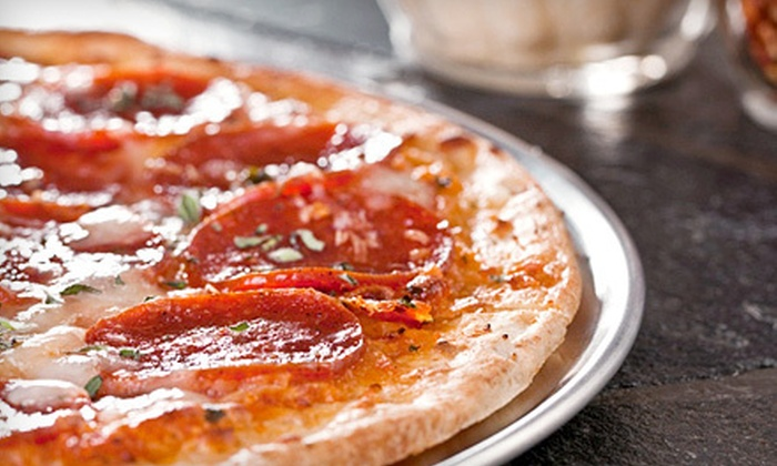 Marco's Pizzeria - Tierra Verde: $12 for Pizza Lunch with 18-Inch Pizza and Large Salad at Marco's Pizzeria in Tierra Verde (Up to $29.90 Value)