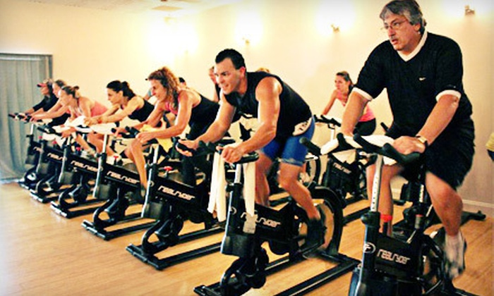 Iron Lion Fitness Studio - Wellington Green: Three or Six Yoga or RealRyder Spinning Classes at Iron Lion Fitness Studio in Wellington (Up to 66% Off)