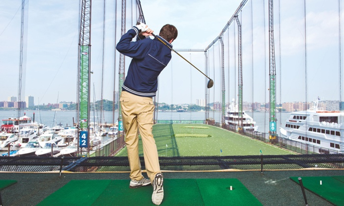 Golf Club at Chelsea Piers - Chelsea Piers: Range Balls and Club Rental or Golf-Simulator Package at Golf Club at Chelsea Piers (Up to 58%  Off)