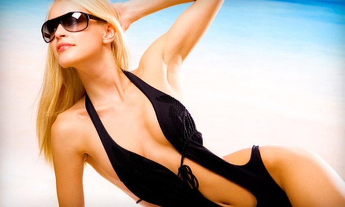 Darque Tan - Multiple Locations: Three Mystic Tan Spray Tans or a Grand Tour Package with Five UV Tans at Darque Tan (Up to 83% Off)