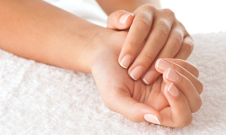 One Basic Pedicure, or One or Two Basic Mani-Pedis at Hair Play Salon & Spa (Up to 54% Off)