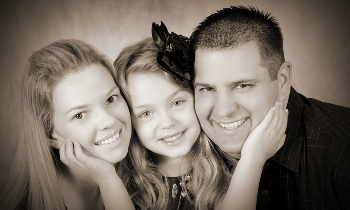 Worth A 1000 Words Studio - Southwest Topeka: $29 for Single-PosePhoto Package with Shoot and Christmas Cards at Worth A 1000 Words Studio ($107.65)