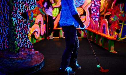 Two Rounds of Blacklight Miniature Golf at Cosmic Mini Golf (43% Off)