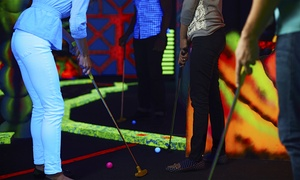 Cosmic Mini Golf: Two Rounds of Black-Light Mini Golf with Chips and Drinks for Two or Four at Cosmic Mini Golf (Up to 57% Off)