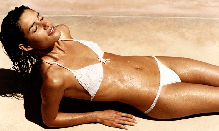 TNT Tanning - Multiple Locations: One Spray Tan, One Month of Unlimited UV Tanning, or Two Body Wraps at TNT Tanning (Up to 72% Off)