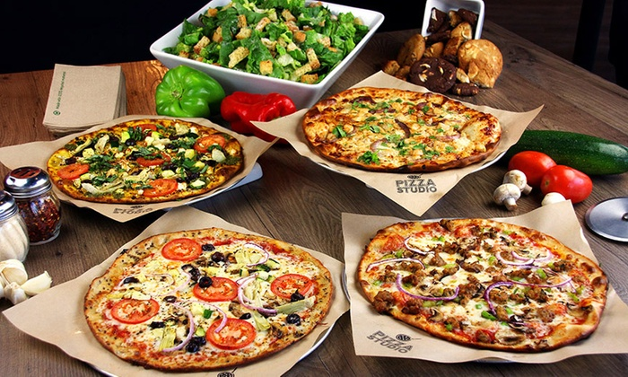 Pizza Studio - Hadley, MA - Hadley: Pizza or Salad with Unlimited Toppings at Pizza Studio (44% Off). Two Options Available.