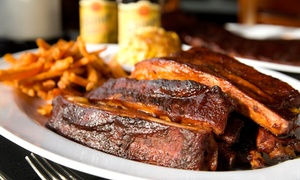 ON Q Smokehouse Grill: $11 for $20 Worth of Barbecue and Drinks for Two or More at ON Q Smokehouse Grill