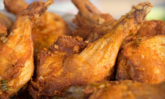 Boujhetto's Soul Food Restaurant - North Linden: Dinner for Two or Four, Wings Meal, or Tailgate Package for Up to 12 at Boujhetto's Soul Food Restaurant (Up to 63% Off)