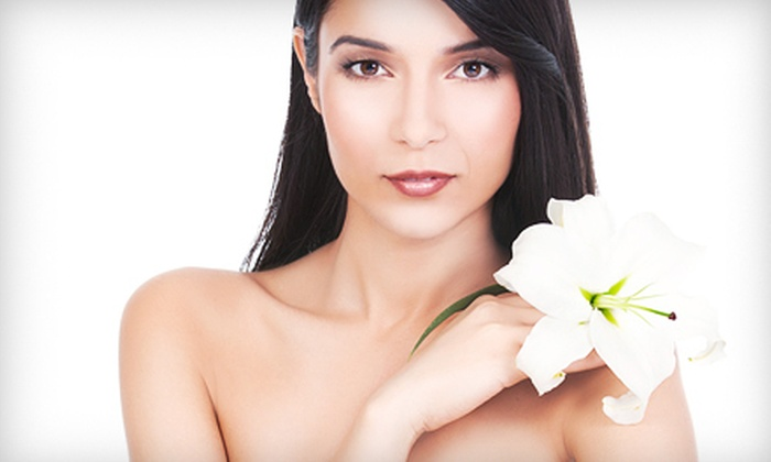 Bloom at Lotus Spa & Salon - Canton: $60 for Facial with Peel or Massage with Body Wrap at Bloom at Lotus Spa & Salon ($120 Value)